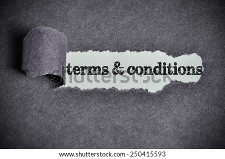 terms & conditions word under torn black sugar paper  - stock photo