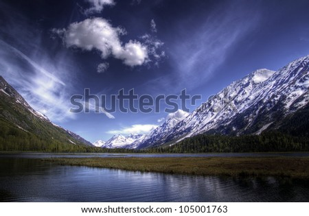 Tern Lake on the Kenai Peninsula in Alaska in summer with bright blue skies and nice clouds. - stock photo