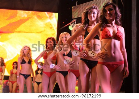 """TERNOPIL, UKRAINE - FEBRUARY 24: Girls dressed in swimsuits in selection round of beauty competition """"Miss Ukraine"""" on February 24, 2012 in Ternopil. - stock photo"""