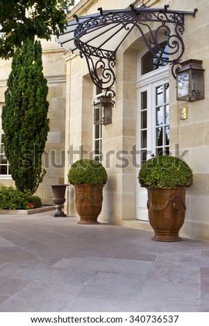 Terrace and garden in the courtyard of a French mansion - stock photo