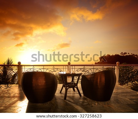Terrace lounge with rattan armchairs and seaview in a luxury resort . Summer holiday concept - stock photo