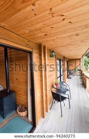 Terrace of mountain wooden lodge. Fox Glacier Lodge, Fox Glacier, West Coast, South Island, New Zealand. - stock photo