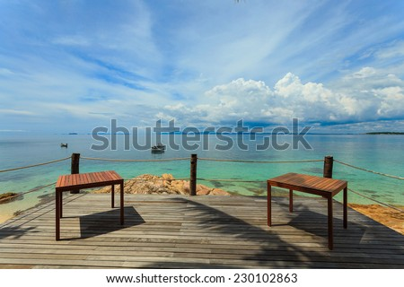 Terrace sea view with outdoor wood table, Munork island, Rayong, Thailand - stock photo