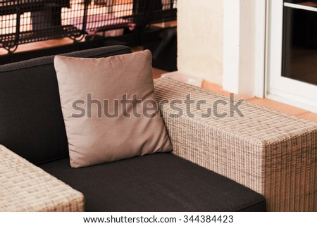terrace with rattan chair - stock photo