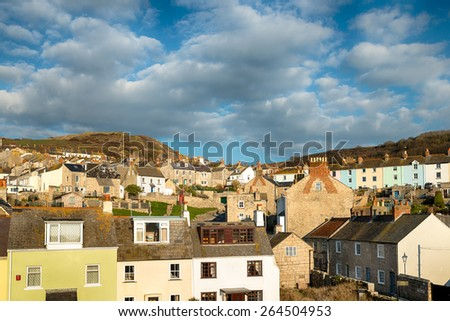 Terraced houses lining the hillside at Chiswell on the Isle of Portland near Weymouth in Dorset - stock photo