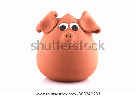 terracotta piggy bank, isolated on white background - stock photo