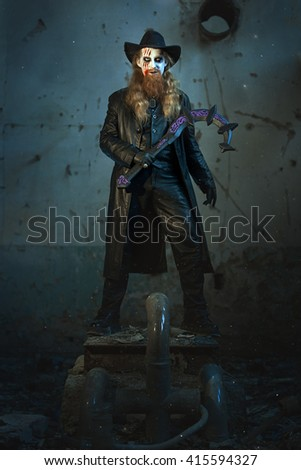 Terrible and evil man, in his hand a sickle to kill. - stock photo