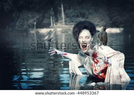Terrible demon with raven in the bloody shirt standing in the river - stock photo