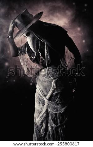 Terrible plague doctor. Medieval Europe. Halloween. - stock photo