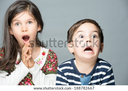 Terrified and surprised two little children - stock photo