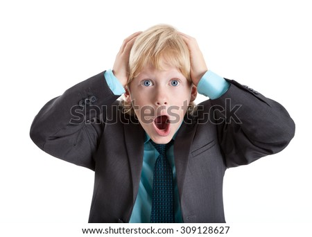 Terrified blond hair boy clutched at his head and screaming, isolated on white background - stock photo