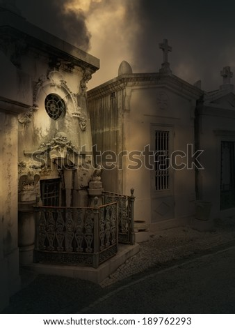 Terrifying tomb of an old European cemetery - stock photo