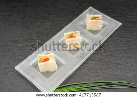 Terrine of smoked halibut mousse and cheese with thin wheat toast - stock photo