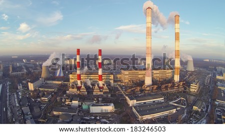 Territory of power plant at winter. View from unmanned quadrocopter - stock photo