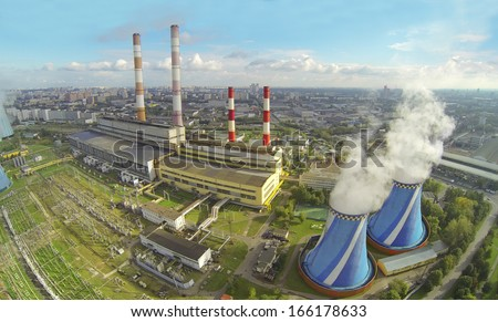 Territory of power plant with many pipes at sunny day. View from unmanned quadrocopter. - stock photo