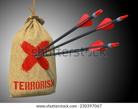 Terrorism - Three Arrows Hit in Red Target on a Hanging Sack on Green Bokeh Background. - stock photo