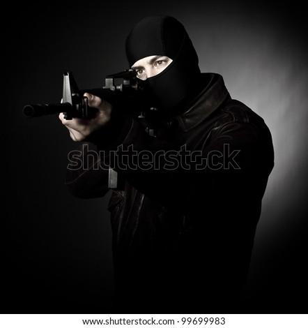 terrorist portrait  with m4 weapon - stock photo