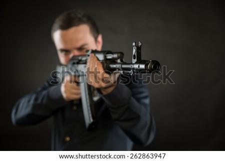 terrorist with kalashnikov isolated on a black background - stock photo