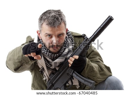 Terrorist with rifle pointing his finger for you, isolated on white background - stock photo
