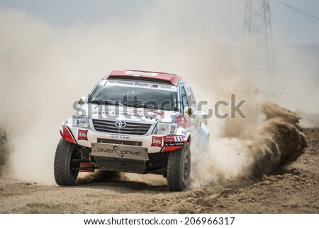 TERUEL, ARAGON/SPAIN - JULY 19: Belgian Driver, Reinaldo Varela, tries to get a good result in SS2 in Baja Aragon Rally on July 19, 2014 in Teruel - stock photo