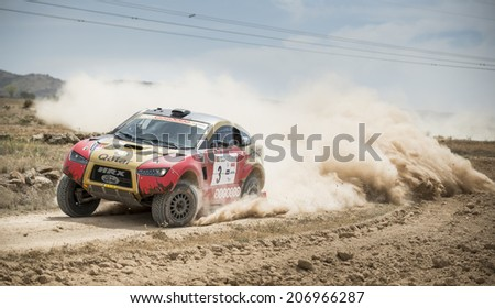 TERUEL, ARAGON/SPAIN - JULY 19: Catari Driver, Nasse Al-Attiyah, tries to get a good result in SS2 in Baja Aragon Rally on July 19, 2014 in Teruel - stock photo