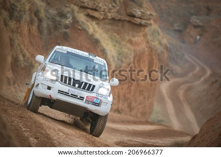TERUEL, ARAGON/SPAIN - JULY 18: Spanish Driver, Giancarlo Mammoli, tries to get a good result in prologue in Baja Aragon Rally on July 18, 2014 in Teruel - stock photo