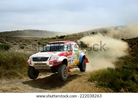 TERUEL, SPAIN - JUL 19 : Brazilian driver Reinaldo Varela and his codriver Gustavo Guglemin in a Toyota Hilux Overdrive race in the XXXI Baja Spain, on Jul 19, 2014 in Teruel, Spain. - stock photo
