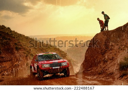 TERUEL, SPAIN - JUL 19 : Spanish driver Jose Zaragoza and his codriver Ignacio Ramirez in a  race in the XXXI Baja Spain, on Jul 19, 2014 in Teruel, Spain. - stock photo