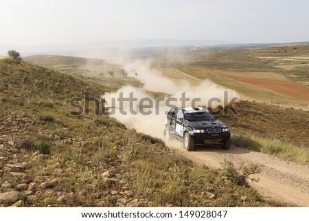 TERUEL, SPAIN - JULY 20. Hungarian driver Pal Lonyai  and  co driver Zoli Garamv���¶lgyi  in a BMW X5 CC, race in Baja Spain, on Jul 20, 2013 in Teruel, Spain. - stock photo