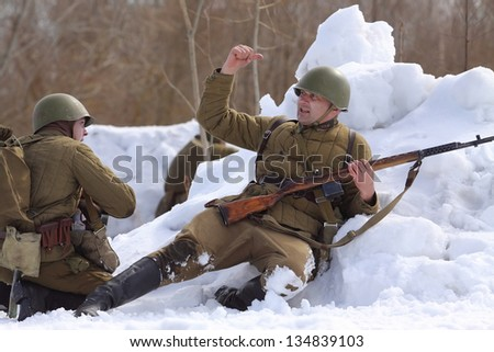 TESSOVO-NETYLSKI, RUSSIA - APR 07: Historical reenactment of the battles for the corridor supply the 2nd Shock Army (april-may 1942) on april 07, 2013 in Tessovo-Netylski, Novgorod region, Russia - stock photo