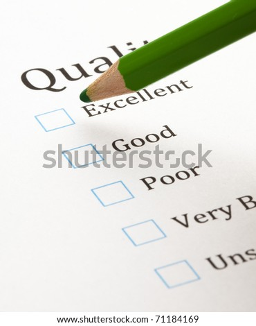 test check boxes and green pen closeup - stock photo