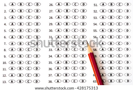 Test score sheet with answers and pencil. Education concept - stock photo