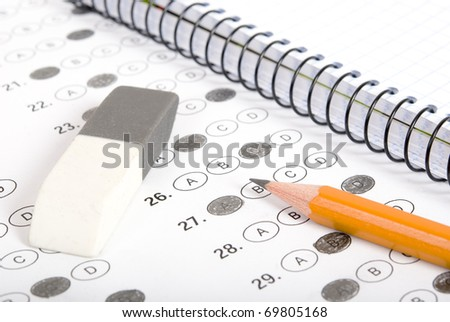 Test score with pencil, notebook and eraser - stock photo