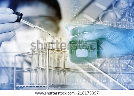 Test tubes closeup,medical glassware. Man wears protective goggles - stock photo