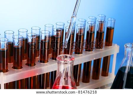 Test tubes closeup on blue background - stock photo