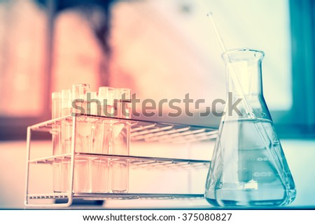 Test tubes in red and blue tone. - stock photo