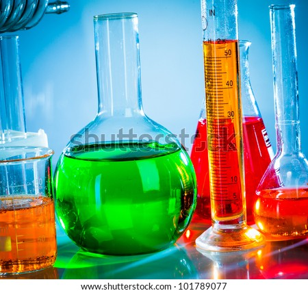 Test tubes on blue background - stock photo