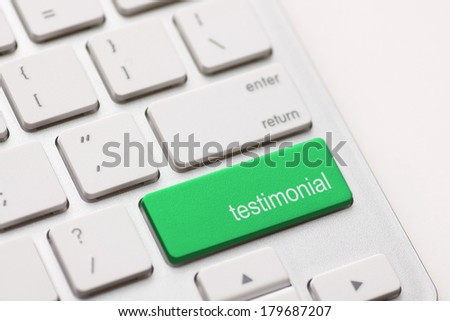 Testimonial button key on white keyboard. - stock photo