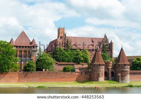 Teutonic Knights in Malbork castle in summer. World Heritage List UNESCO - stock photo