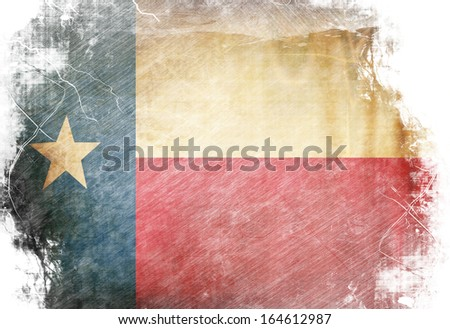 Texan flag waving in the wind with some spots and stains - stock photo