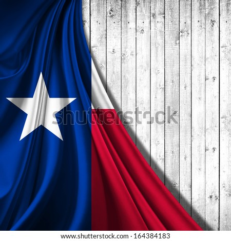 texas flag fabric,wood background  - stock photo