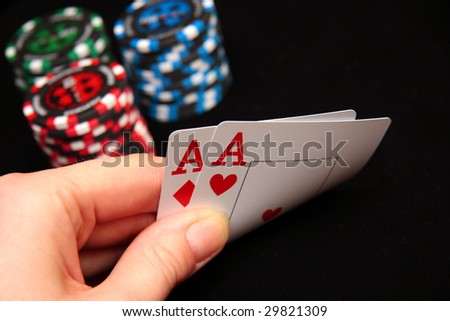 texas hold'em poker hand - pair of Aces - stock photo