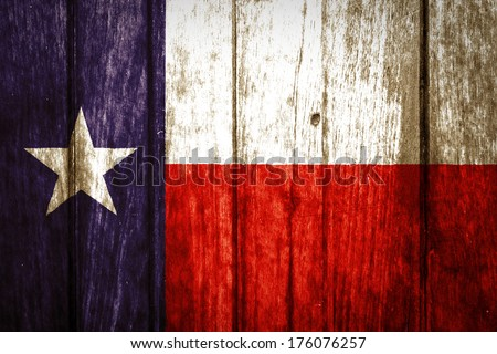 Texas State Flag painted on old wood plank texture - stock photo