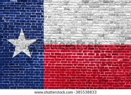 Texas US flag painted on old vintage brick wall - stock photo