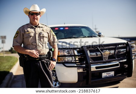 TEXAS, USA - AUGUST 5, 2013: Policeman in Texas on August 5, Adrian, USA - stock photo