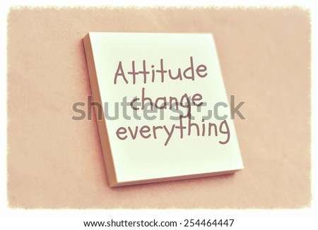 Text attitude change everything on the short note texture background - stock photo