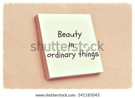 Text beauty in ordinary things on the short note texture background - stock photo