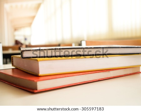Text book on the desk in library and shallow dof.  - stock photo