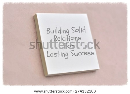 Text building solid relations for lasting success on the short note texture background - stock photo