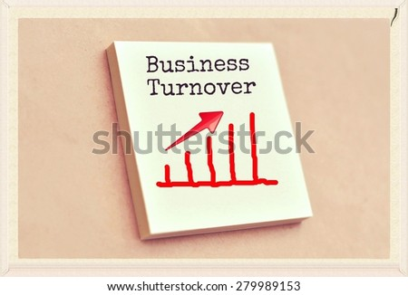 Text business turnover on the graph goes up on the short note texture background - stock photo